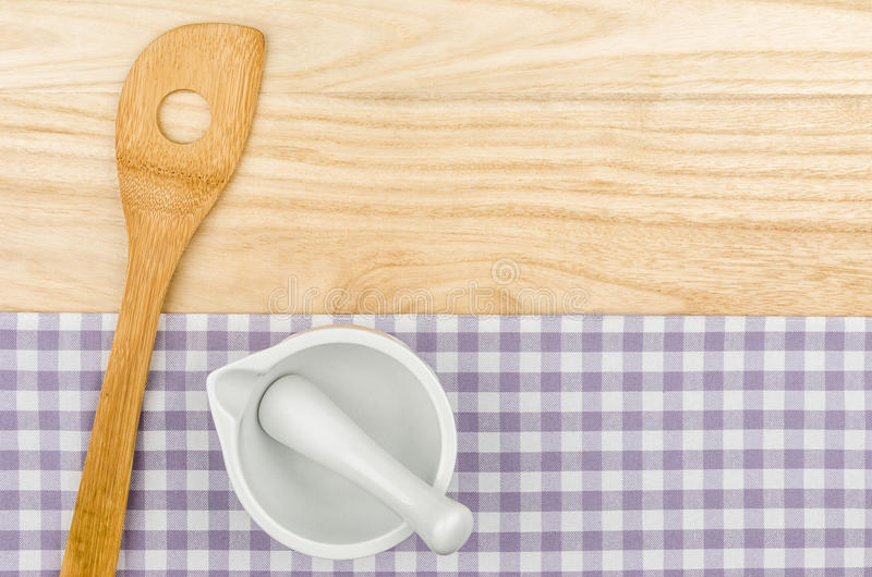 Download Wooden Spoon And Mortar On A Purple Checkered Table Cloth Stock Photo - Image of mortar, shabby: 32190318