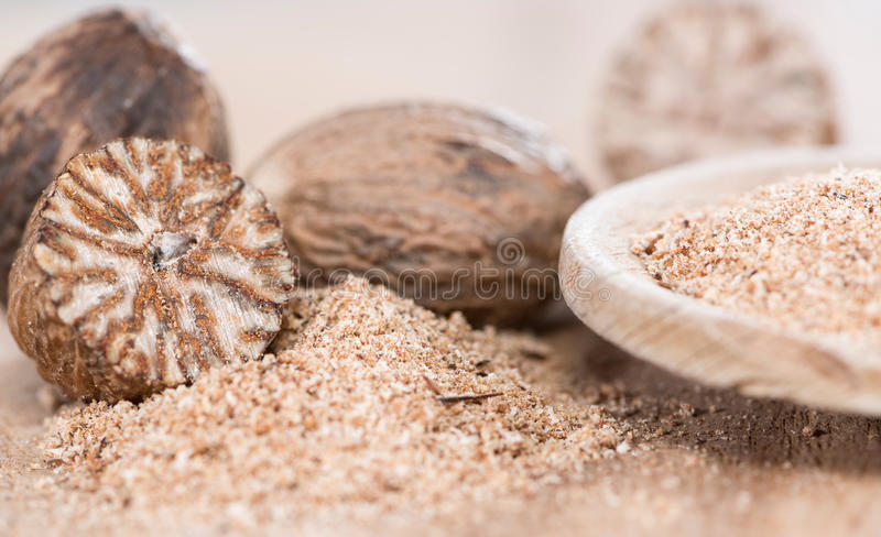 Wooden spoon with Nutmeg Powder. (close-up shot royalty free stock photography