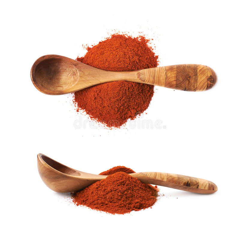 Wooden spoon over the pile of paprika. Isolated over the white background, set of two different foreshortenings royalty free stock image