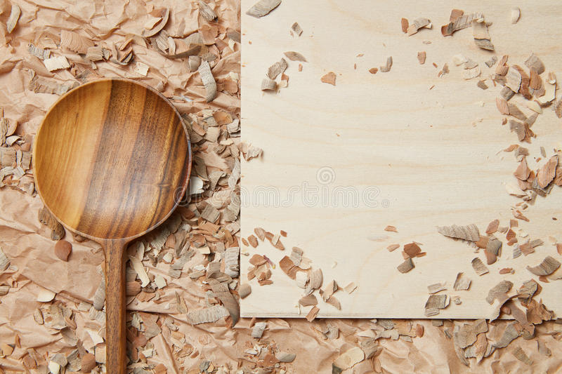Wooden spoon on parchment stock photos