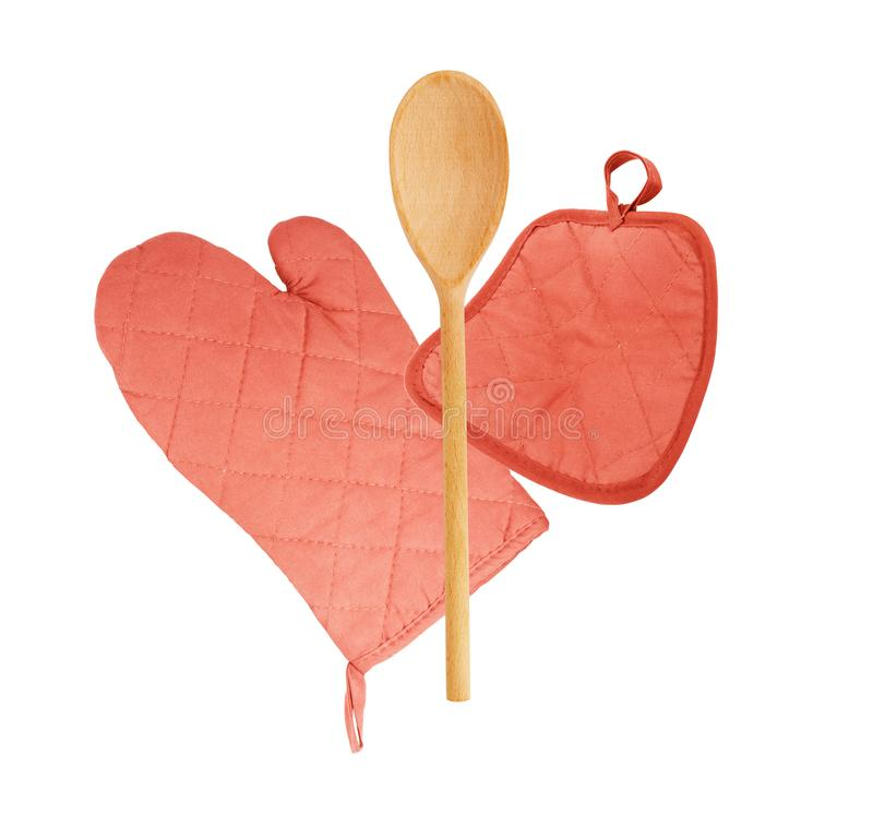 Wooden spoon with quilted heat protective mitten on a white background royalty free stock photos