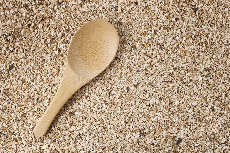 Wooden spoon on wooden sawdust royalty free stock photography