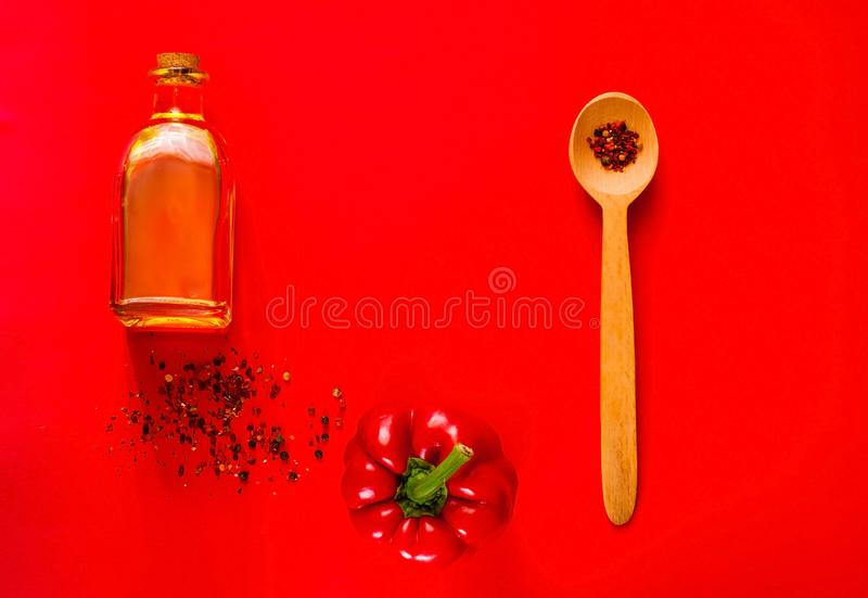 Wooden spoon with spices and Creative red pepper for cooking on red background.Healthy food, vegan or diet nutrition concept. Background layout with copy space stock photos