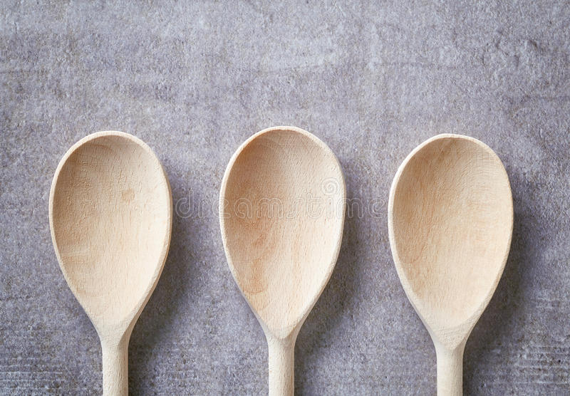 Wooden spoon on stone table, from above royalty free stock photo