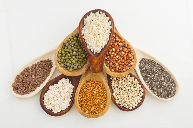 Wooden spoons with assorted grains of super foods, gluten free.  royalty free stock image