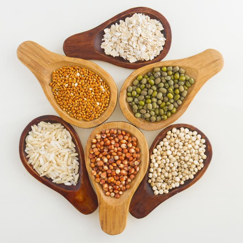 Wooden spoons with assorted grains of super foods, gluten free.  royalty free stock photos