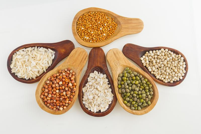 Wooden spoons with assorted grains of super foods, gluten free stock image