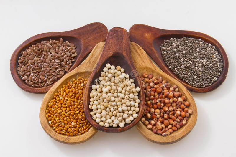 Wooden spoons with assorted grains of super foods, gluten free royalty free stock photography