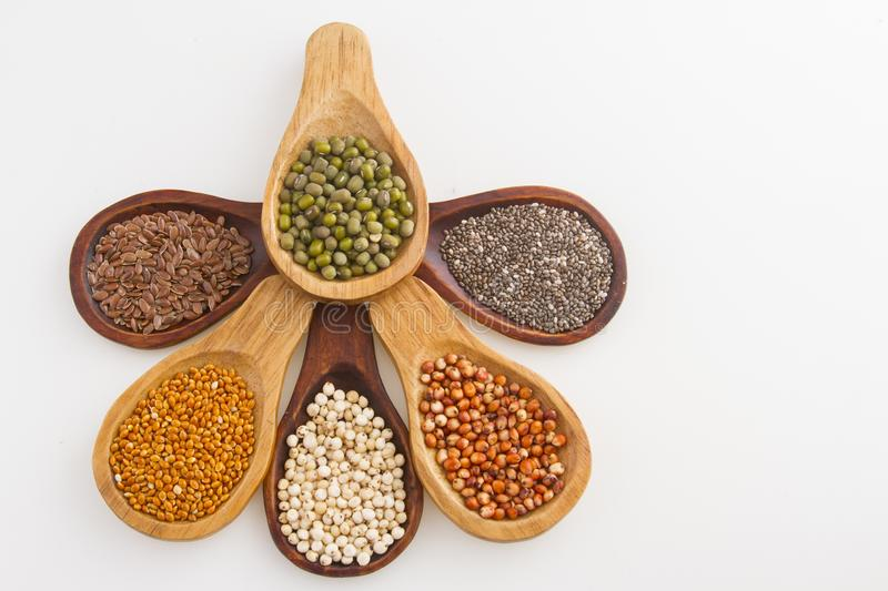 Wooden spoons with assorted grains of super foods, gluten free.  royalty free stock images