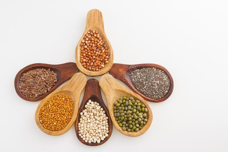 Wooden spoons with assorted grains of super foods, gluten free.  royalty free stock photo