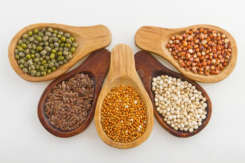 Wooden spoons with assorted grains of super foods, gluten free royalty free stock photos