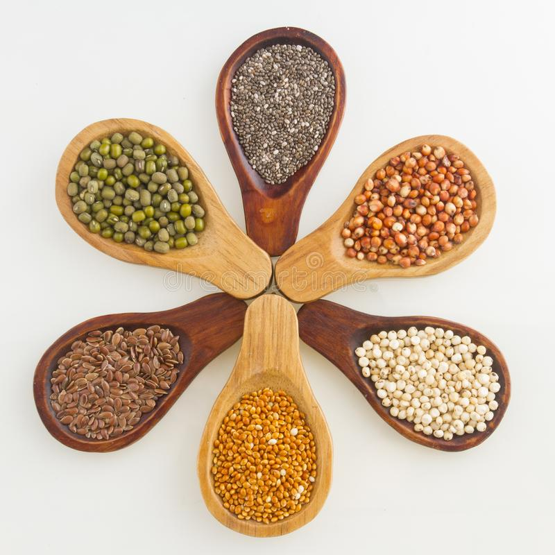 Wooden spoons with assorted grains of super foods, gluten free.  stock image