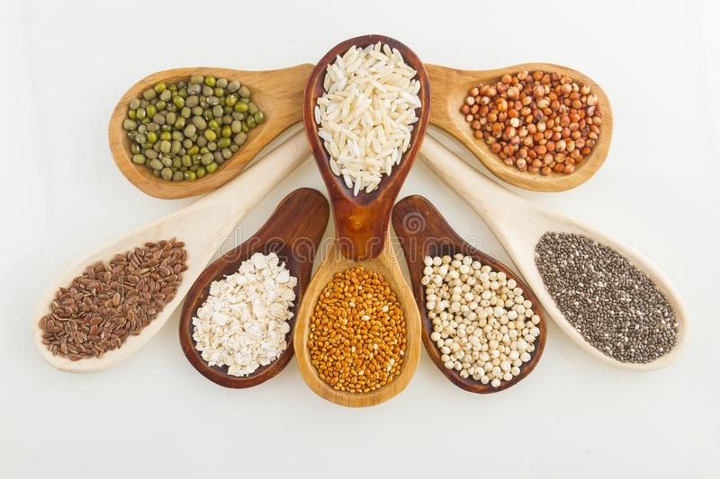 Wooden spoons with assorted grains of super foods, gluten free stock photo
