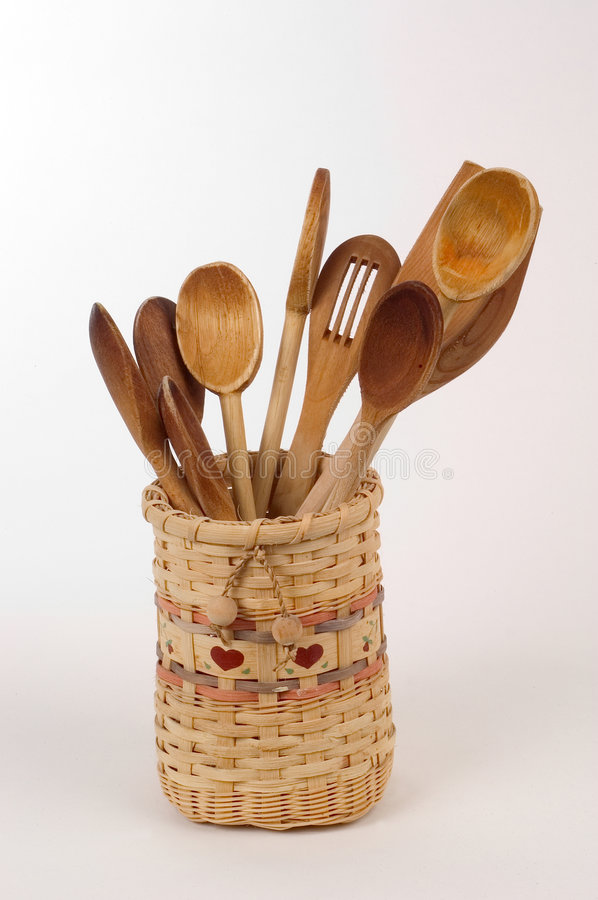 Wooden spoons in a basket royalty free stock photo