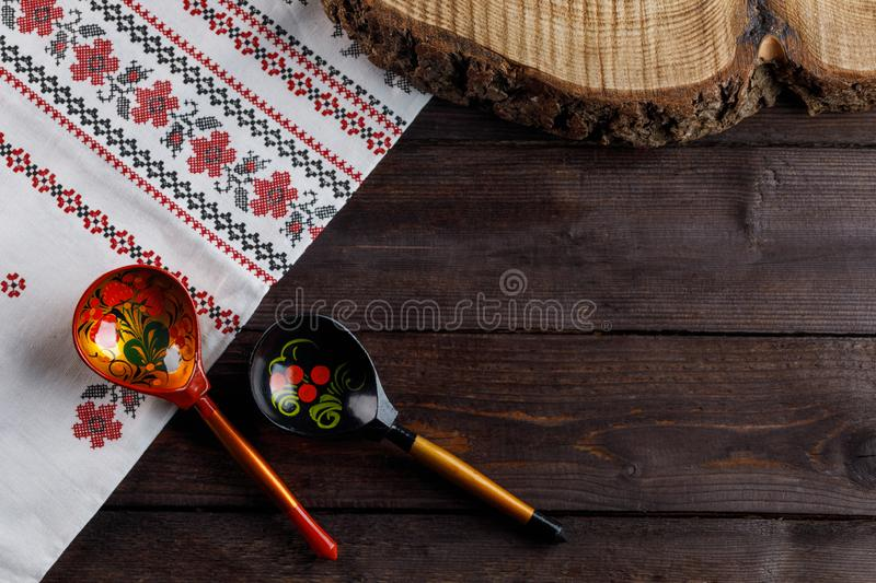 Wooden spoons with floral ornament in traditional folk Russian Khokhloma style on wooden table with a tablecloth with a royalty free stock photos