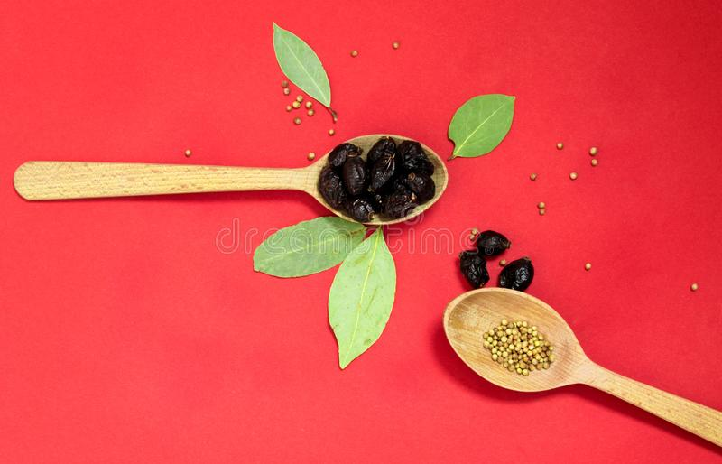 Wooden spoons with pepper and dried berries top view royalty free stock image