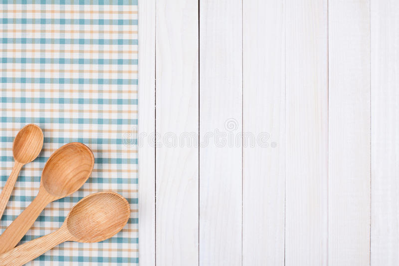 Wooden spoons on tablecloth