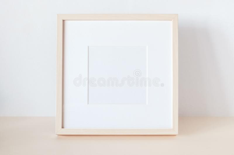 Wooden Square Frame with Poster Mockup stock photo