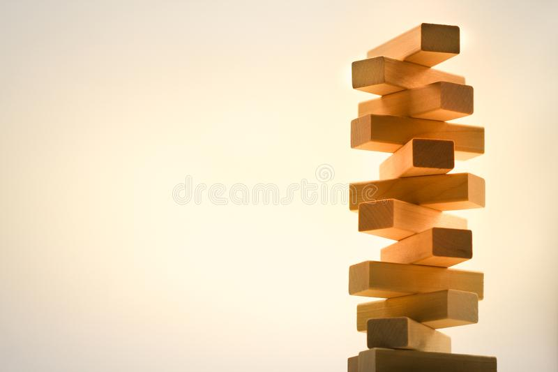 Wooden stack tower from wood blocks toy on abstract background royalty free stock photos