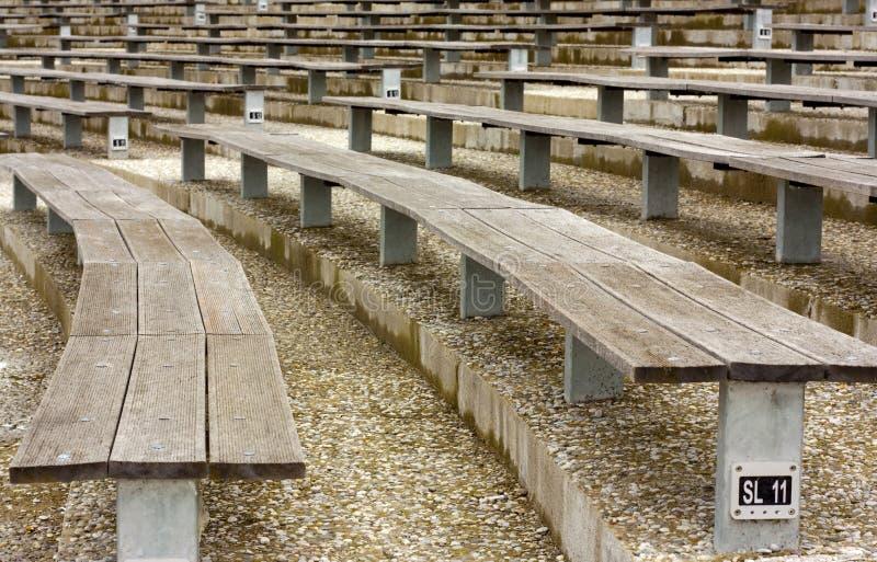 Wooden stadium seats. Rows of empty wooden stadium seats royalty free stock photos