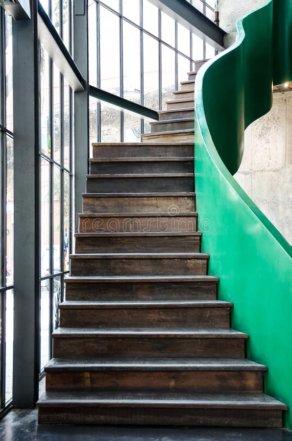 Wooden stair with green handrail royalty free stock photos