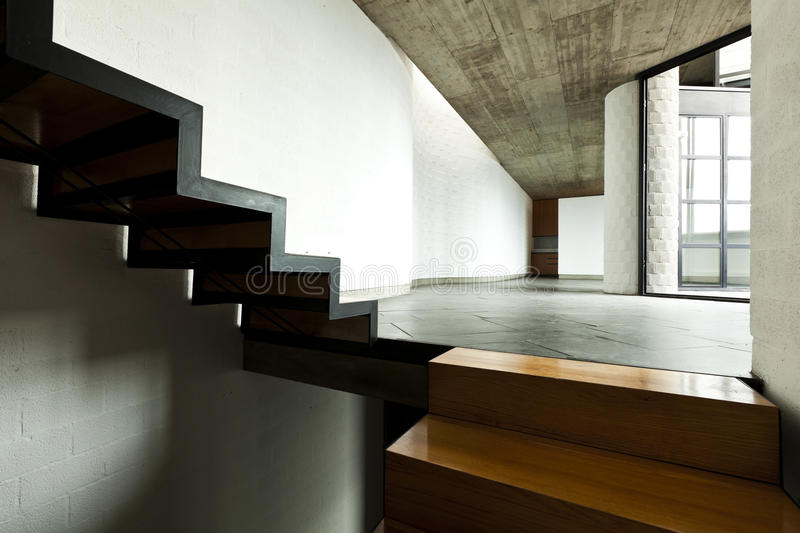 Wooden staircase. Interior modern villa, wooden staircase royalty free stock images