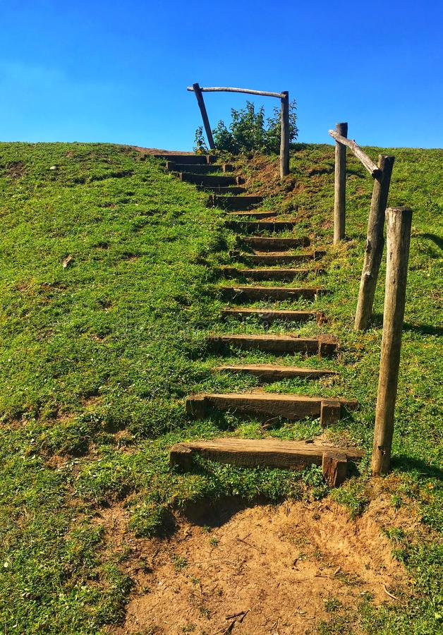 Wooden staircase on a hill to help people climb it easily stock images