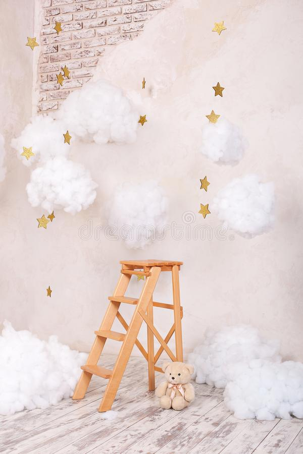 Wooden staircase stool with clouds in the children room. Children location for a photo shoot. Scandinavian style. Rustic room inte stock images