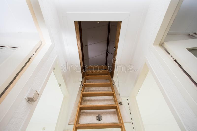Wooden staircase to the attic in a modern house stock photography