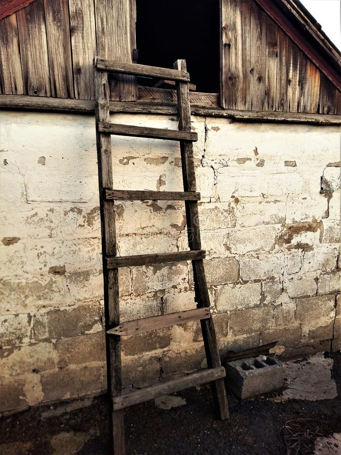 The wooden staircase to the loft of the barn royalty free stock image