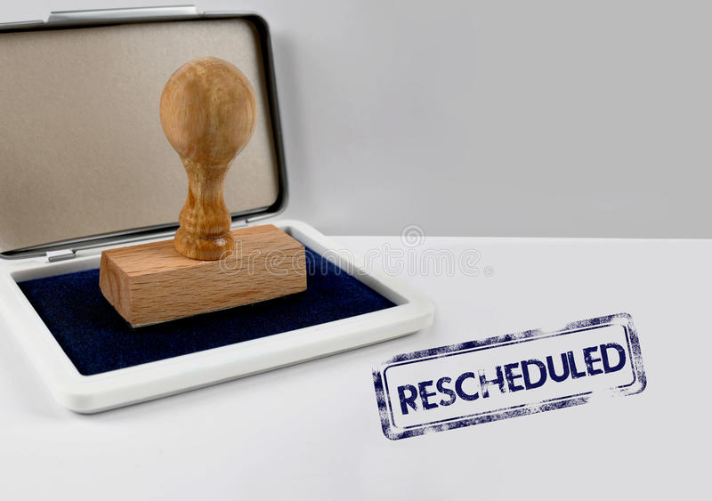 Wooden stamp RESCHEDULED royalty free stock photo