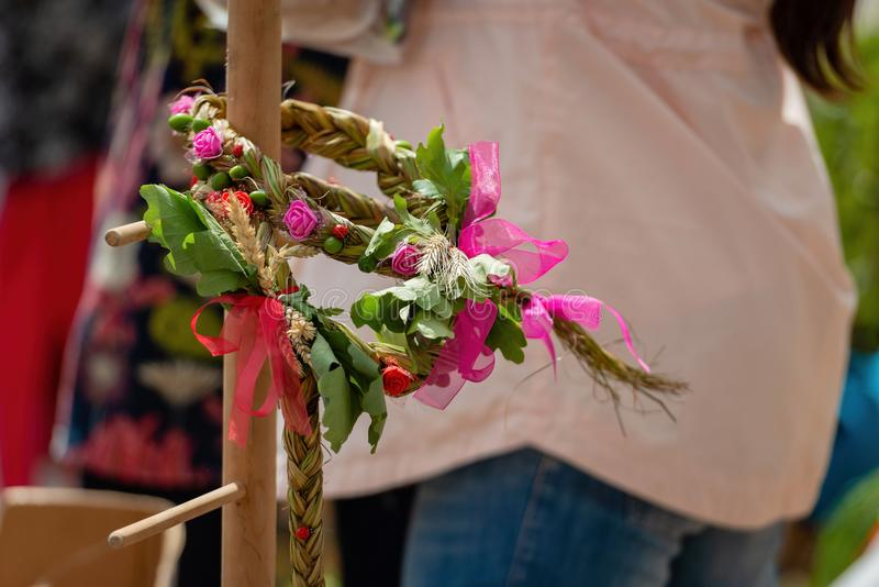 Wooden stand with the flowers braided crown. The Latvian Ligo ho. Liday attribute stock photo