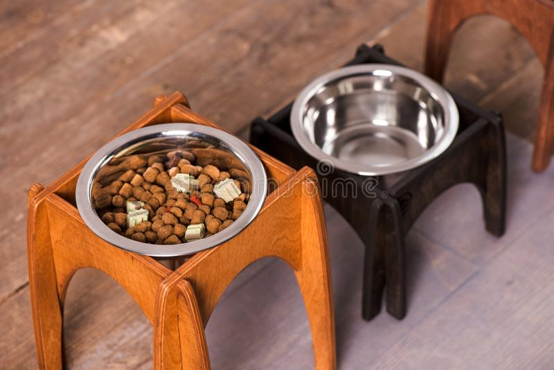 Stand for a bowl of dogs. dog food. bowl for dogs. Wooden stand. product with wood. stand with wood for a bowl of dogs. food in a bowl. dog food stock photography