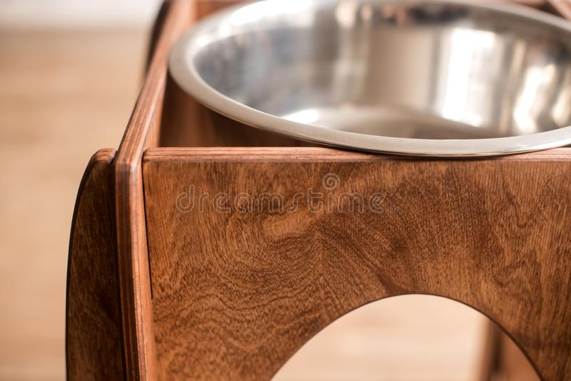Stand for a bowl of dogs. dog food. bowl for dogs. Wooden stand. product with wood. stand with wood for a bowl of dogs. food in a bowl. dog food stock image