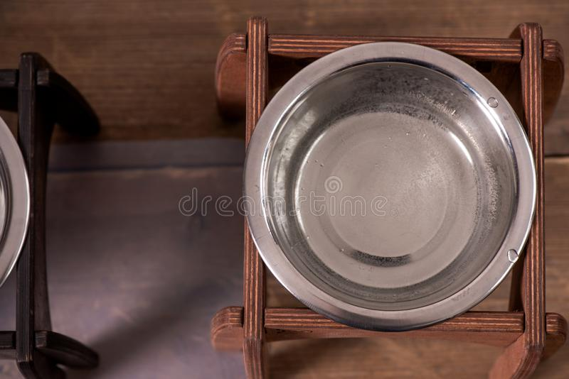 Stand for a bowl of dogs. dog food. bowl for dogs. Wooden stand. product with wood. stand with wood for a bowl of dogs. food in a bowl. dog food royalty free stock image