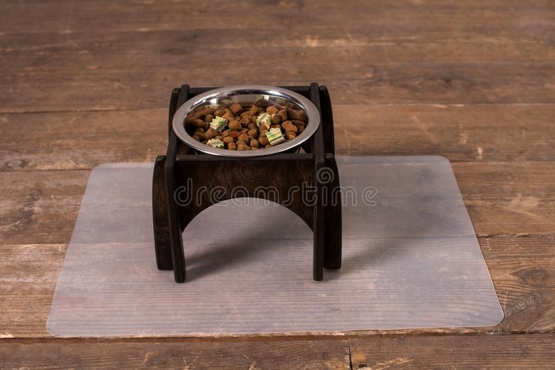 Stand for a bowl of dogs. dog food. bowl for dogs. Wooden stand. product with wood. stand with wood for a bowl of dogs. food in a bowl. dog food royalty free stock images