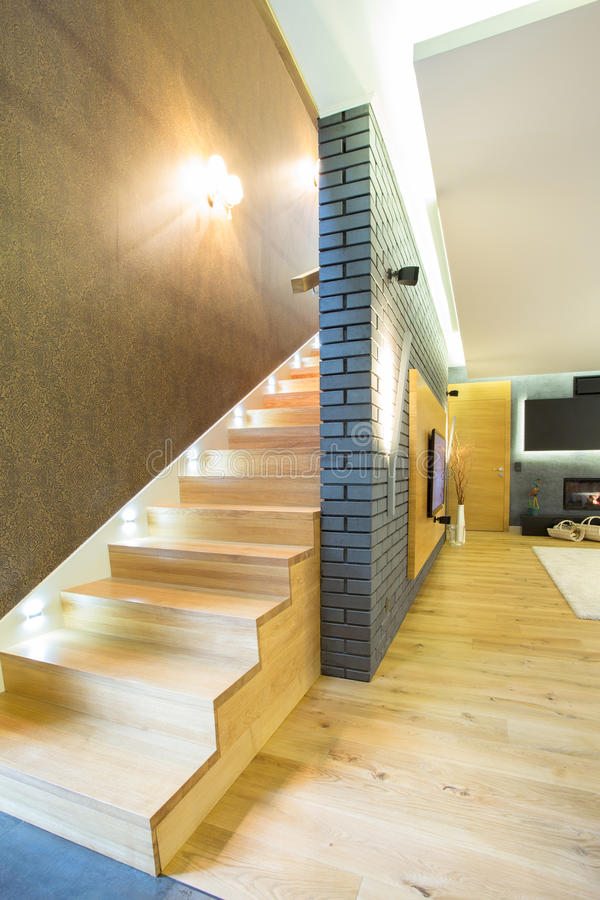 Wooden staricase inside designed apartment stock images