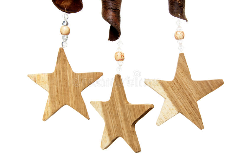 Wooden Stars. Three Wooden Stars Decorations with Beads and Pods, Isolated on White Background stock photography
