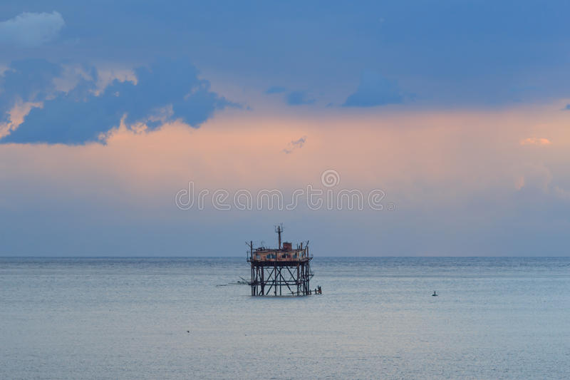 Wooden station in the middle of the sea. royalty free stock images