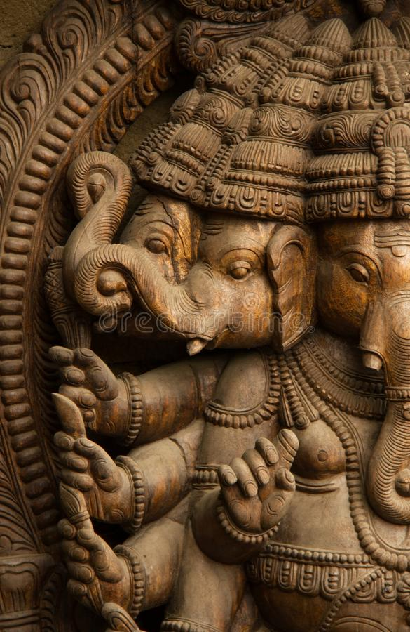 Wooden statue of Hindu god stock photo