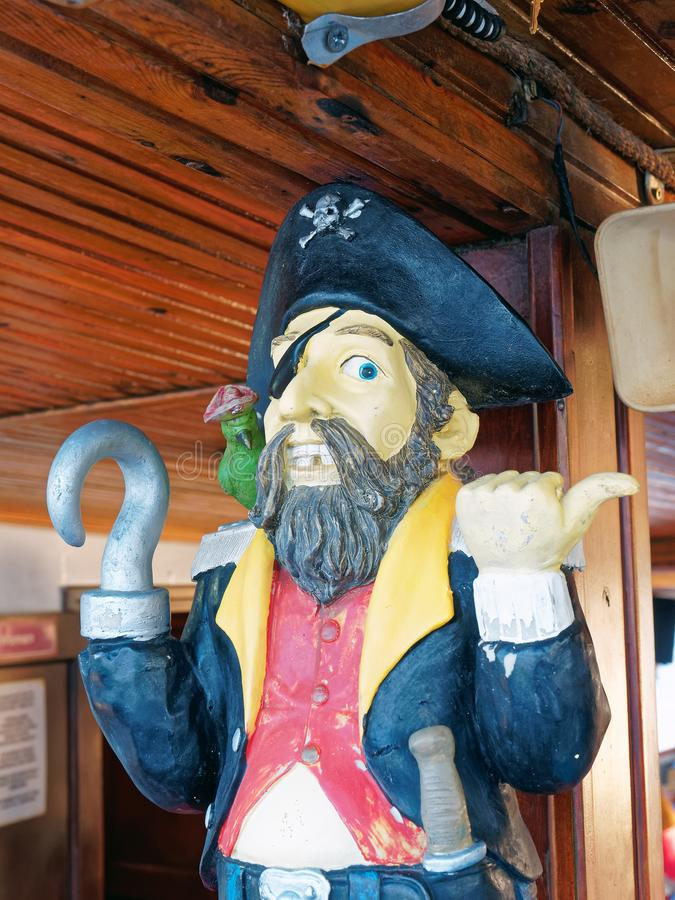 Captain Hook Pirate Wood Carving stock images