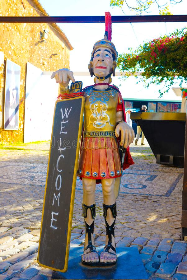 Welcome Sign, Wooden statue of a Roman soldier, Travel Portugal, Faro Medieval and Historical Downtown Area stock photo