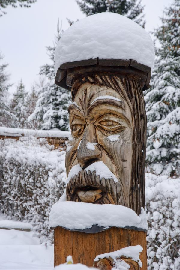 Wooden statue stock image