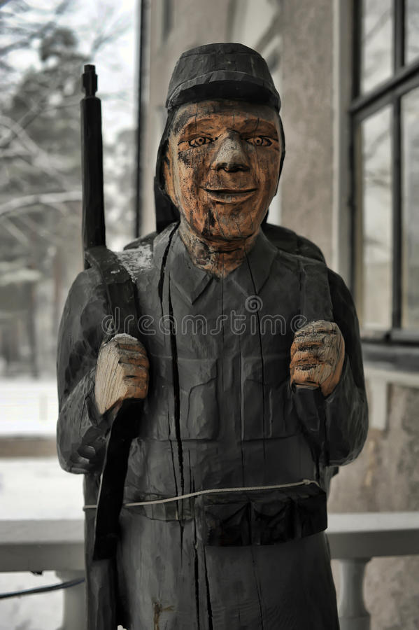 Wooden statue of a soldier stock image