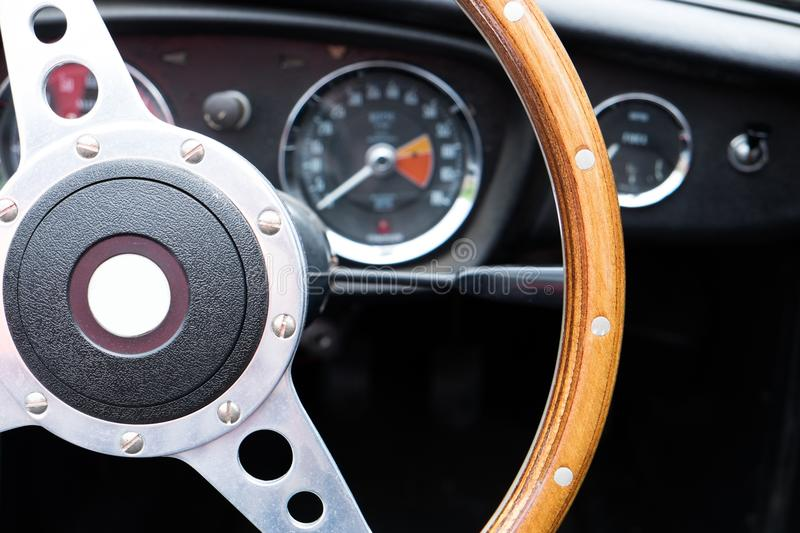 Wooden steering wheel - MGB roadster. Wooden steering wheel from a classic MGB roadster car royalty free stock photography