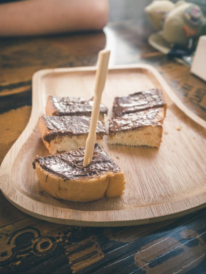 Wooden stick into the chocolate on topping toast royalty free stock photos