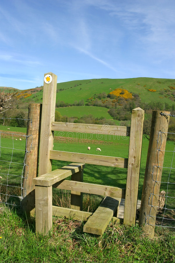 Wooden Stile. With countryside to the rear, set against a blue sky royalty free stock images