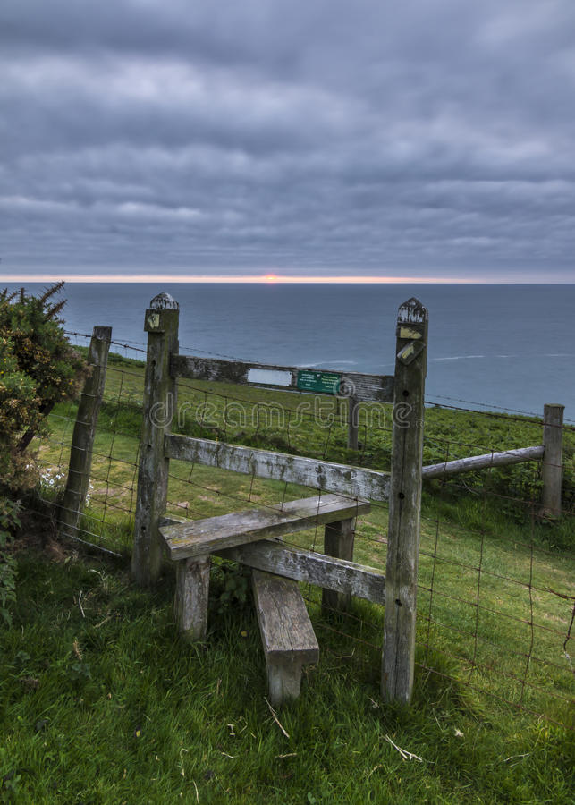 Wooden stile on the Welsh coastal path. Near the village of Aberaeron, Ceredigion stock photo