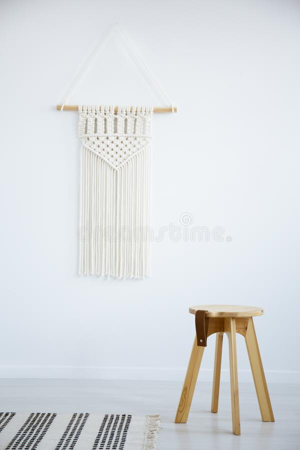 Wooden stool and rug in white simple living room interior with d royalty free stock images