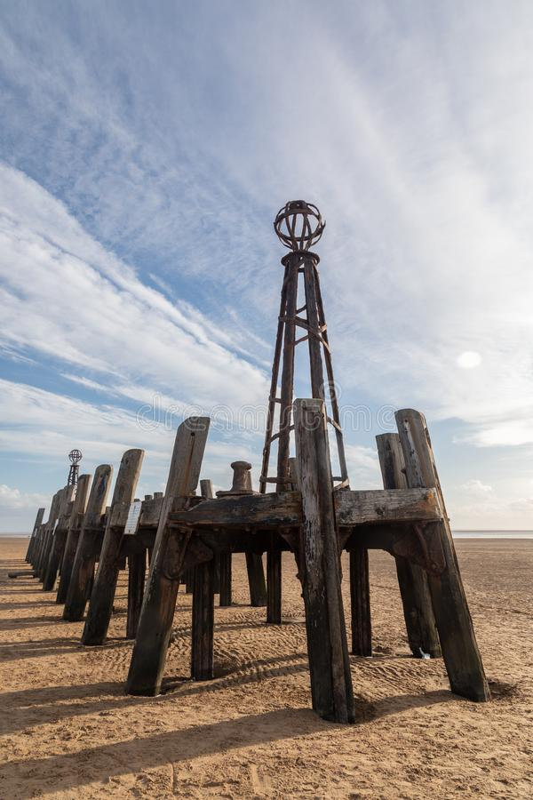 Wooden structure on the beach at St Annes on Sea Fylde Coast February 2019. Wooden structure designed to limit waves on the pier on the beach at St Annes on Sea stock photo